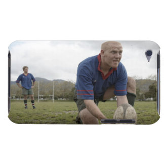 Rugby player positioning ball on rugby pitch iPod touch covers
