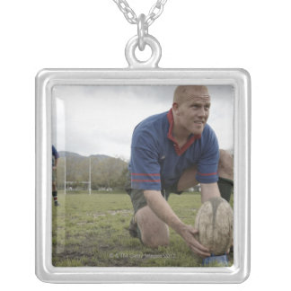 Rugby player positioning ball on rugby pitch silver plated necklace