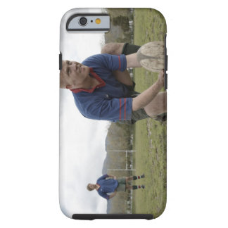 Rugby player positioning ball on rugby pitch tough iPhone 6 case