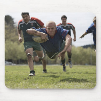 Rugby player scoring jumping on groud with ball mouse mat