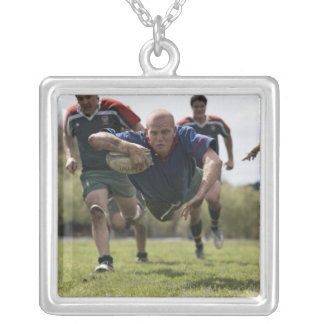 Rugby player scoring jumping on groud with ball silver plated necklace