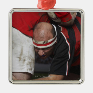 Rugby player tacking opponent, mid section Silver-Colored square decoration