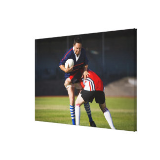 Rugby player tackling another canvas print