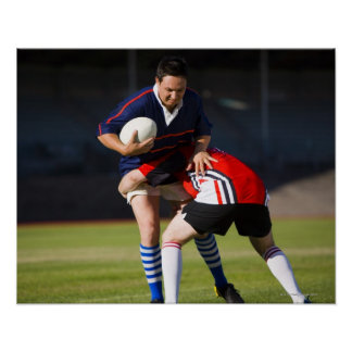Rugby player tackling another poster