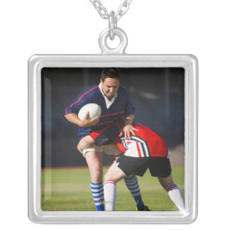 Rugby player tackling another silver plated necklace