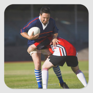 Rugby player tackling another square sticker