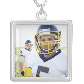 rugby player wearing helmet and standing silver plated necklace