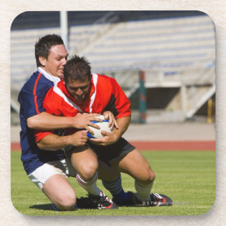 Rugby players fighting for ball drink coaster