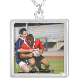 Rugby players fighting for ball silver plated necklace