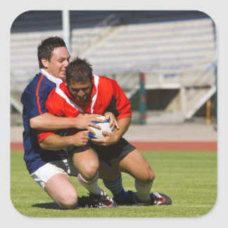 Rugby players fighting for ball square stickers