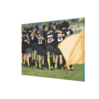 Rugby team standing in a circle canvas print