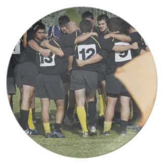 Rugby team standing in a circle plate