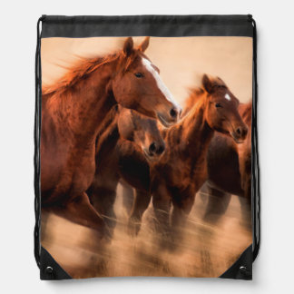 Running horses, blur and flying manes drawstring bag