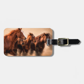 Running horses, blur and flying manes luggage tag