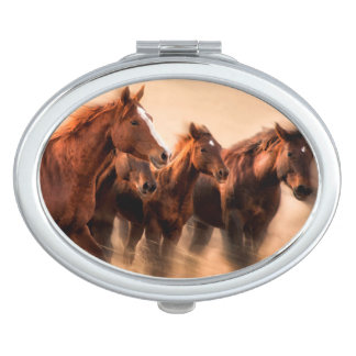 Running horses, blur and flying manes makeup mirrors
