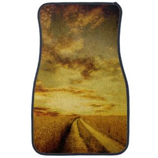 Rural dirt road through the field car mat