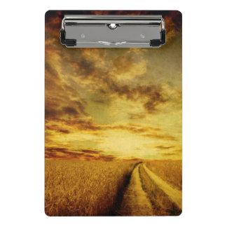 Rural dirt road through the field mini clipboard