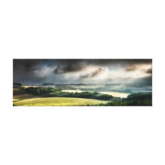 Rural landscape lit up with daybreak sunshine canvas print