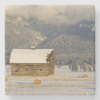 Rustic barn and hay bales after a fresh snow 2 stone coaster