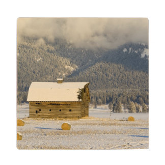 Rustic barn and hay bales after a fresh snow 2 wood coaster