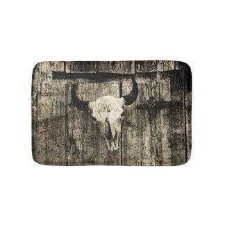 Rustic buffalo skull with horns on a barn bath mat