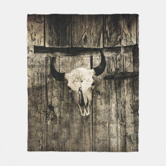 Rustic buffalo skull with horns on a barn fleece blanket