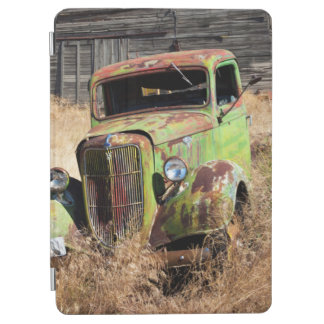 Rusting car in front of abandoned farm iPad air cover