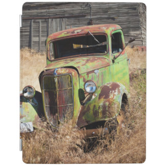 Rusting car in front of abandoned farm iPad cover