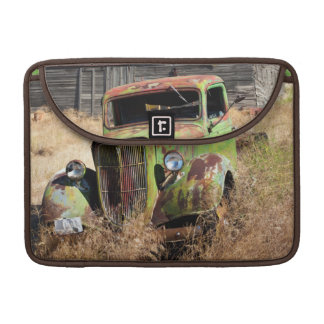 Rusting car in front of abandoned farm sleeve for MacBook pro