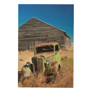 Rusting car in front of abandoned farm wood wall art