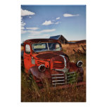 Rusting orange Dodge truck with abandoned farm