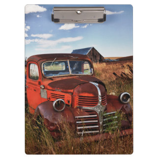 Rusting orange Dodge truck with abandoned farm Clipboard