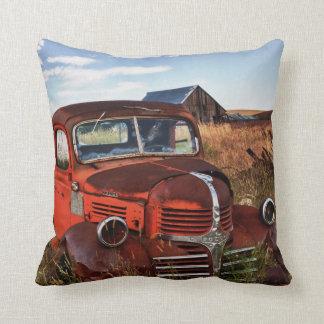 Rusting orange Dodge truck with abandoned farm Cushion