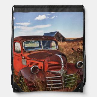 Rusting orange Dodge truck with abandoned farm Drawstring Bag
