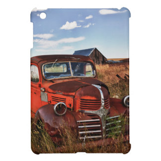Rusting orange Dodge truck with abandoned farm iPad Mini Covers