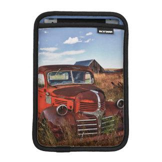 Rusting orange Dodge truck with abandoned farm iPad Mini Sleeves