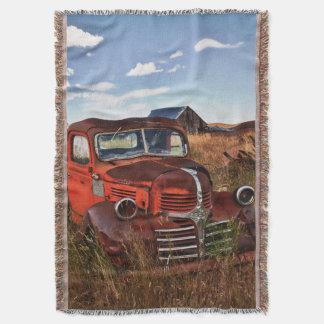 Rusting orange Dodge truck with abandoned farm Throw Blanket
