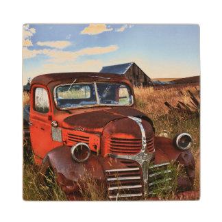 Rusting orange Dodge truck with abandoned farm Wood Coaster