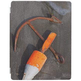 Rusty Anchor And Buoy On A Beach iPad Cover