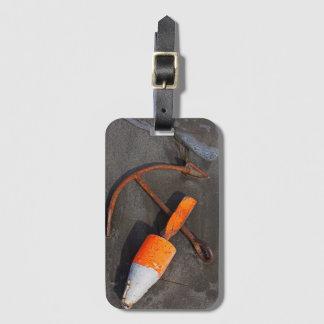 Rusty Anchor And Buoy On A Beach Luggage Tag