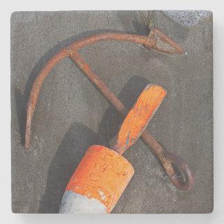 Rusty Anchor And Buoy On A Beach Stone Coaster
