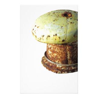 Rusty bollard isolated on white background stationery