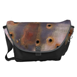 Rusty bullet hole messenger bags
