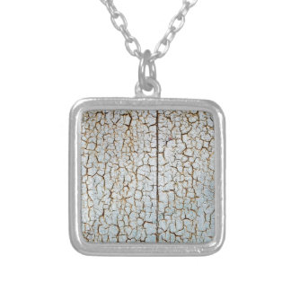 Rusty metal surface is covered with a thick layer square pendant necklace