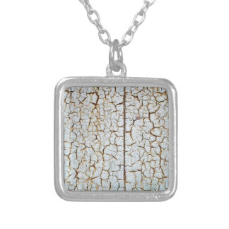 Rusty metal surface which has cracked from age square pendant necklace