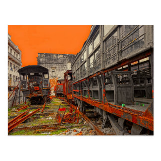 Rusty old locomotives and train wagons postcard