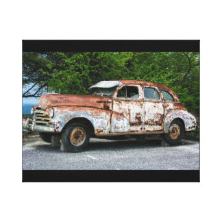Rusty old vintage car on canvas