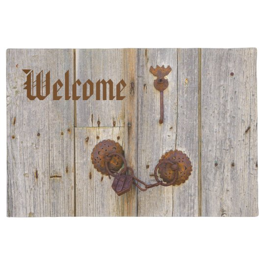 Rusty vintage old padlock on wooden door Welcome Doormat