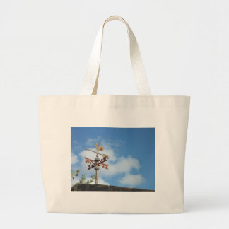 Rusty Weathervane against blue sky Jumbo Tote Bag