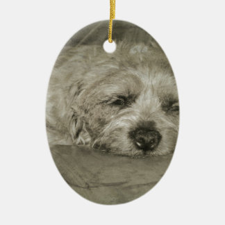 Sad sleepy dog ceramic oval decoration